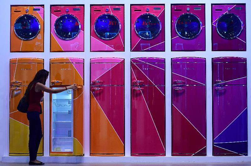 A woman looks at a fridge installation at the Vestel booth at the IFA electronics trade fair in Berlin