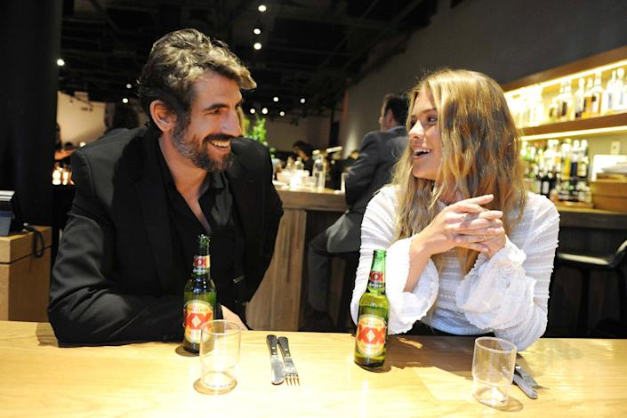 Dos Equis Most Interesting Man and supermodel Nina Agdal have a drink at Cosme in NYC ahead of Cinco de Mayo.