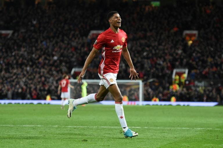 Manchester United's striker Marcus Rashford celebrates scoring their second goal during the UEFA Europa League quarter-final second leg football match against Anderlecht April 20, 2017