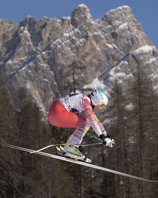 Julia Mancuso of the United States speeds down the course during an alpine ski, women's World Cup downhill, in Cortina D'Ampezzo, Italy, Saturday, Jan. 25, 2014. Mancuso placed 7th. (AP Photo/Domenico Stinellis)