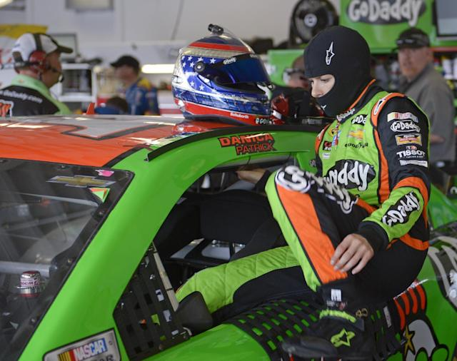 Danica Patrick climbs in her car before the start of a practice session for the Daytona 500 NASCAR Sprint Cup Series auto race at Daytona International Speedway in Daytona Beach, Fla., Friday, Feb. 21, 2014. (AP Photo/Phelan M. Ebenhack)
