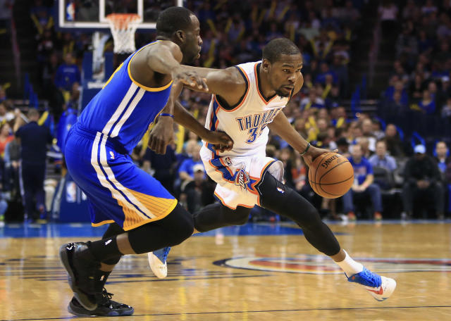 Oklahoma City Thunder small forward Kevin Durant (35) drives to the basket as Golden State Warriors small forward Draymond Green (23) defends during the third quarter of an NBA basketball game Friday, Jan. 17, 2014, in Oklahoma City. (AP Photo/Alonzo Adams)
