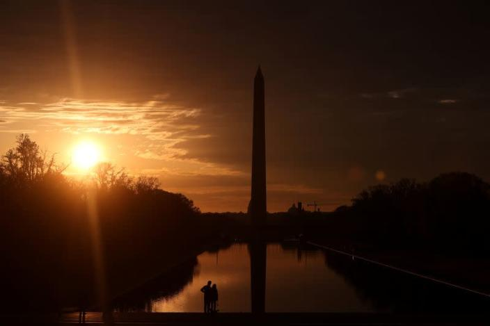 A few people take to the plaza at the Lincoln Memorial during the coronavirus disease (COVID-19) outbreak, where normally thousands of Christians would gather for worship at Easter sunrise, in Washington