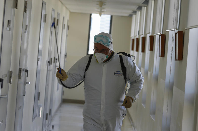 "Local Government Officials and residents disinfect at the National Education Training Institute in the southeastern city of Daegu, South Korea, on March 2, 2020. South Korea reported 476 new cases of the coronavirus on Monday, bringing the total number of infections here to 4,212, as the nation provides an ""all-out response"" to the fast-spreading virus that includes a massive testing program. (Photo by Seung-il Ryu/NurPhoto via Getty Images)"