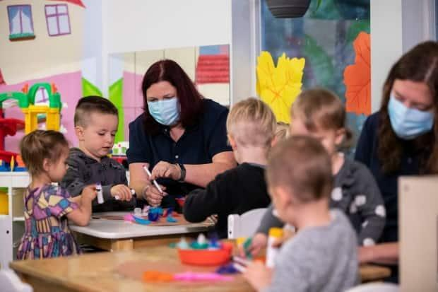 Children are pictured with their daycare workers at Bee Haven Childcare Centre in North Vancouver, British Columbia on Friday Oct. 9, 2020. (Ben Nelms/CBC - image credit)