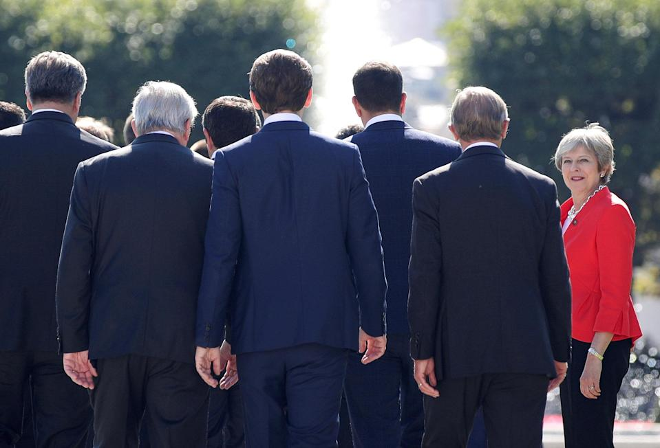 Theresa May arrives for a photo during the European Union leaders informal summit in Salzburg, Austria. (Reuters)
