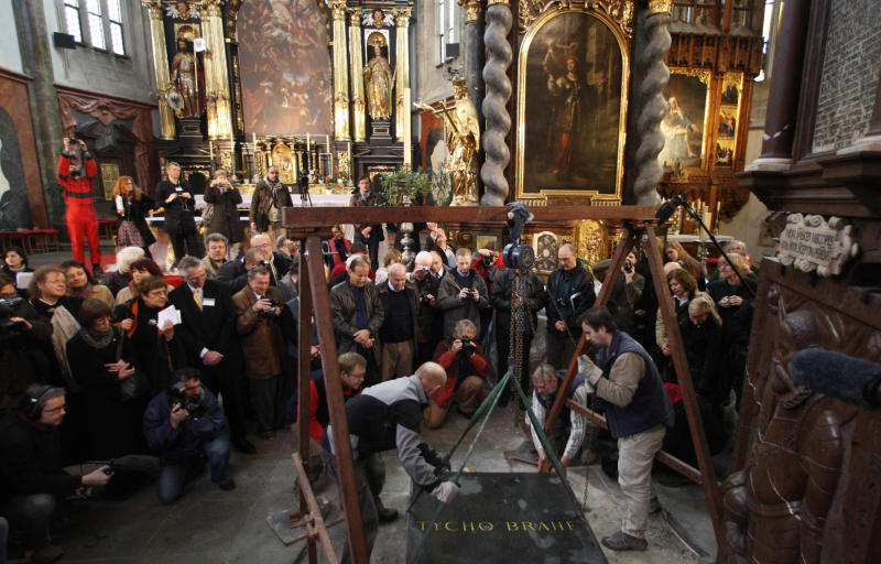 Archeologists lift a tomb stone of a grave of famous Danish astronomer Tycho Brahe at the Church of Our Lady at the Old Town Square in Prague, Czech Republic, Monday, Nov. 15, 2010. An International team of scientists plan to exhume Brahe's remains in efforts to determine the cause of his death. (AP Photo/Petr David Josek)