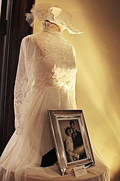 This undated photo provided by Moxie Photography shows a display of vintage wedding dresses belonging to members of the family, that one couple displayed at their wedding reception. Personalizing the décor is a popular trend in wedding receptions, and there are many creative, inexpensive ideas to be found on the Internet's bridal sites and pin boards. (AP Photo/Moxie Photography, Diana Vermeulen)