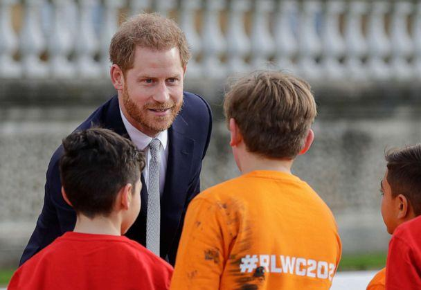 PHOTO: Britain's Prince Harry greets schoolchildren in the gardens at Buckingham Palace in London, Thursday, Jan. 16, 2020. (Kirsty Wigglesworth/AP)