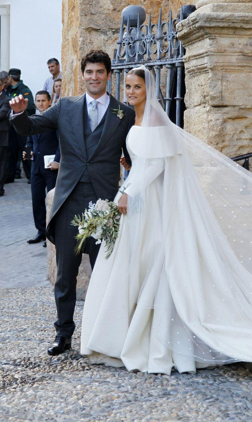 <p>For her wedding to Alejandro Santo Domingo, Lady Charlotte Wellesley, the daughter of Princess Antonia the Duchess of Wellington, chose a structured off-the-shoulder gown by Emilia Wickstead. The Lady paired her layered dress with a sheer veil, which was embroidered with polka dots. </p>