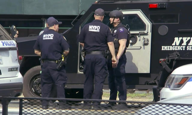 <p>In this image taken from video, officers from the New York Police Department's Emergency Services Unit hold a conversation by an armored vehicle outside Bronx Lebanon Hospital in New York, after a gunman opened fire there on Friday, June 30, 2017. (AP Photo/Joseph Frederick) </p>