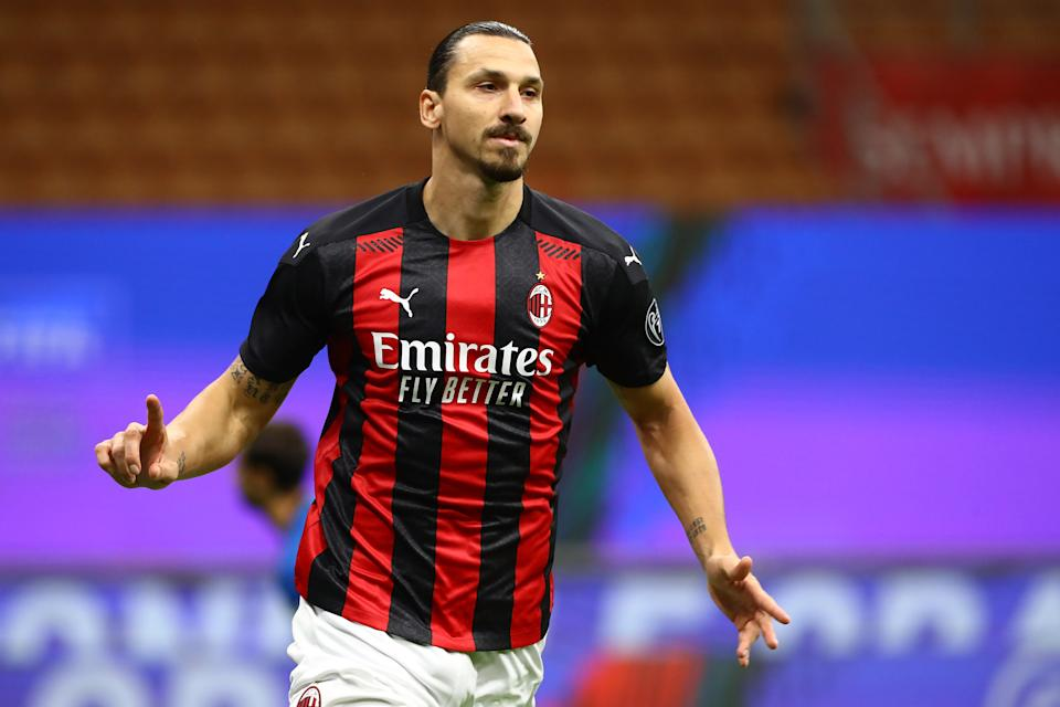 MILAN, ITALY - OCTOBER 26:  Zlatan Ibrahimovic of AC Milan celebrates after scoring the opening goal during the Serie A match between AC Milan and AS Roma at Stadio Giuseppe Meazza on October 26, 2020 in Milan, Italy.  (Photo by Marco Luzzani/Getty Images)
