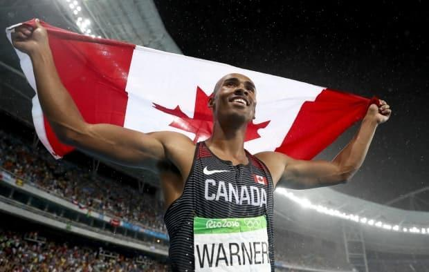 Canada's Damian Warner, shown celebrating his silver medal win at Rio 2016, will be going for gold at Tokyo 2020. Warner was officially nominated to Canada's athletics team on Saturday, joining 56 other athletes. (File/Getty Images - image credit)