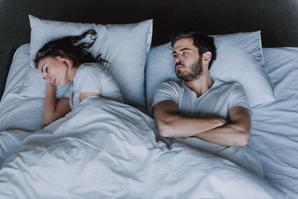 Young Attractive Couple Having Problem in Bed. Frustrated Man and Woman Not Talking Feeling Offended or Stubborn. Concept of Impotence. Man Have Problems.