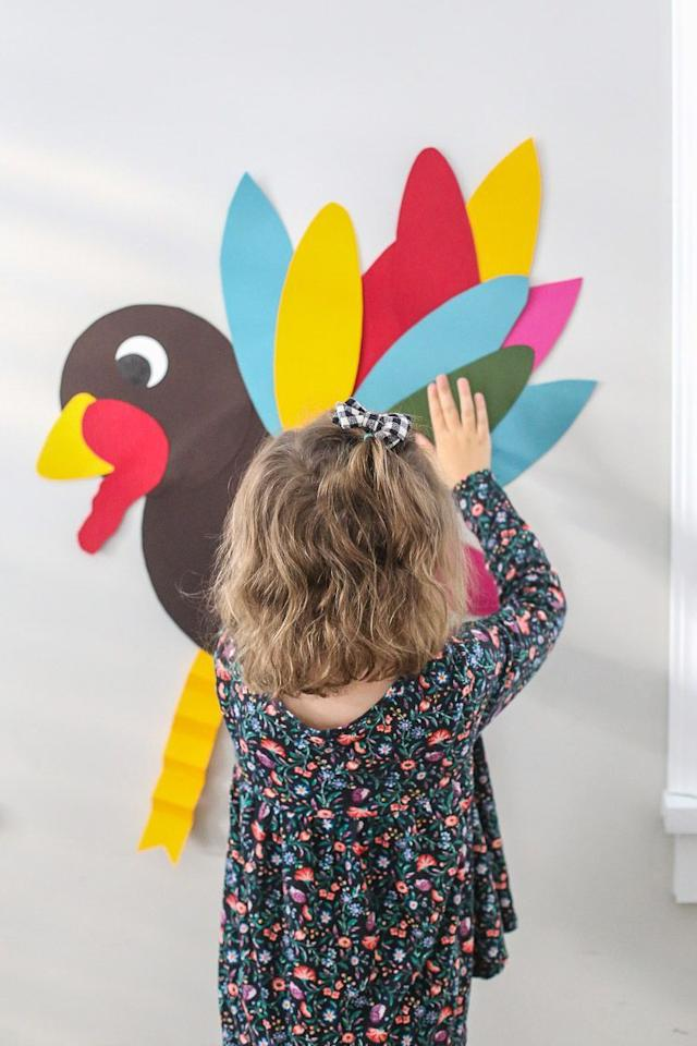 """<p>A little construction paper and painter's tape can go a long way when it comes to entertaining kids on Thanksgiving. All you have to do is cut out the shapes to make a turkey and a bunch of feathers, then you'll play it just like a rousing game of pin the tail on the donkey—except that it's more like tape the tail<em>feather</em> on the turkey. </p><p><em><a href=""""https://thelittlesandme.com/3-kid-approved-friendsgiving-activities/"""" target=""""_blank"""">Get the tutorial at The Littles & Me »</a></em></p><p><strong>More</strong>: <a href=""""https://www.housebeautiful.com/entertaining/holidays-celebrations/g22626327/thanksgiving-craft-ideas/"""" target=""""_blank"""">10 Easy Thanksgiving Craft Ideas the Whole Family Will Love</a><br></p>"""