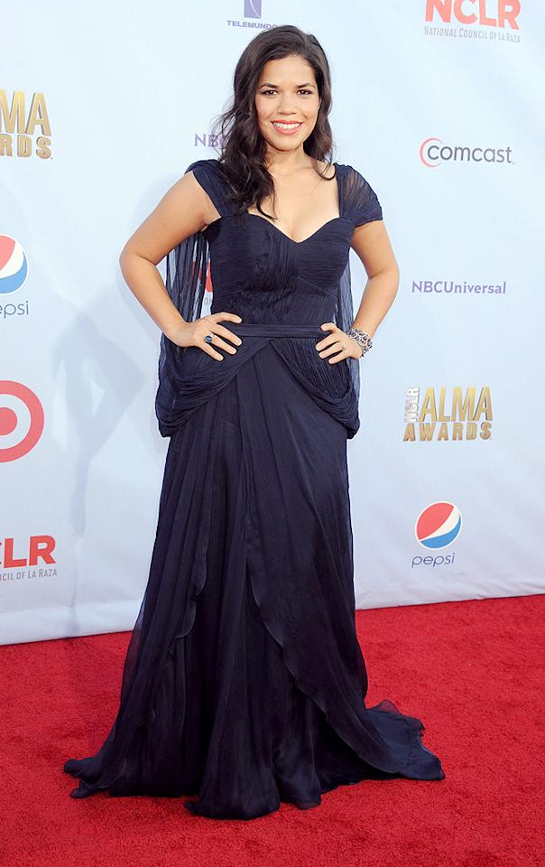 "Presenter America Ferrera hit the red carpet in a navy Carlos Miele gown, which she accessorized with sapphire-and-diamond jewelry by Lorraine Schwartz. And the 28-year-old former ""Ugly Betty"" star let the world know via Twitter that she had a good time at the show. ""#Alma12 fun! W/ @EvaLongoria, @TheRealAnaOrtiz, @justinmachado!! Love my girls!!!,"" she tweeted along with<a target=""_blank"" href=""http://say.ly/OGQ4byq ""> a photo</a> of the foursome."