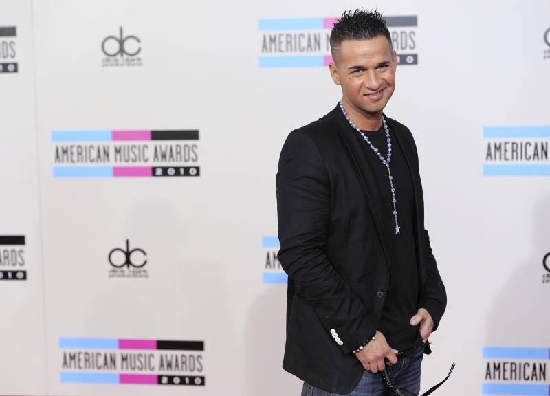 "Mike Sorrentino, also known as ""The Situation"", arrives at the 38th Annual American Music Awards on Sunday, Nov. 21, 2010 in Los Angeles. (AP Photo/Chris Pizzello)"