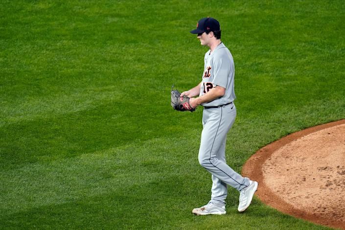 Detroit Tigers pitcher Casey Mize heads to the dugout after he was pulled following a two-run home run by Minnesota Twins' Eddie Rosario in the fifth inning of a baseball game, Wednesday, Sept. 23, 2020, in Minneapolis.
