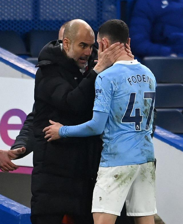 Guardiola (left) continues to be impressed by the development of Phil Foden (right)