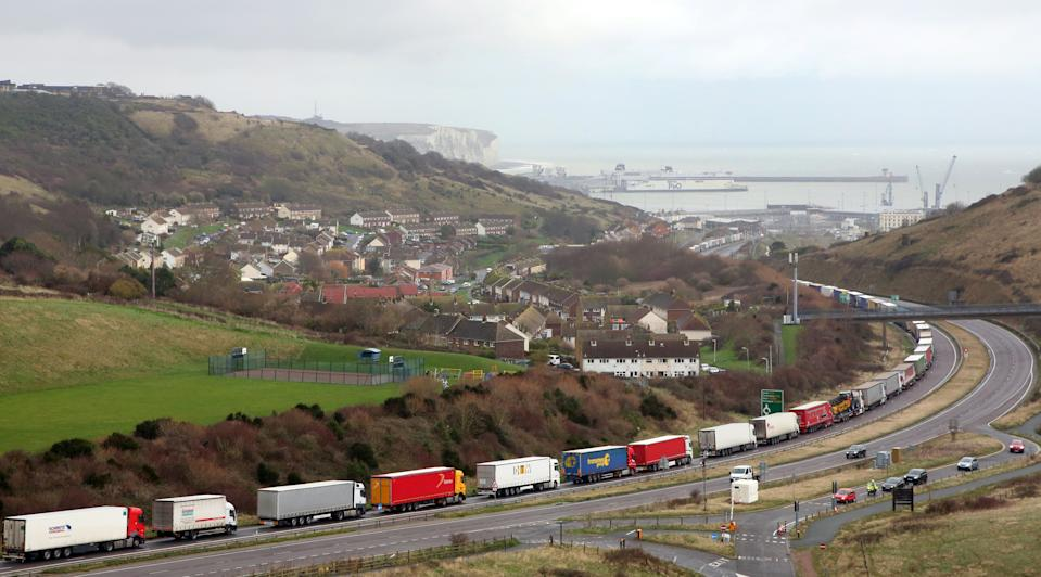 Lorries queue on the A20 to enter the port of Dover in Kent. Christmas stockpiling and Brexit uncertainty have again caused huge queues of lorries to stack up in Kent. The latest delays came as the UK marked less than two weeks until 2021 and the end of the Brexit transition period.