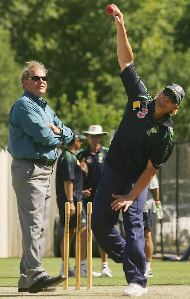 ADELAIDE, AUSTRALIA - NOVEMBER 30:  Shane Warne of Australia in action with mentor Terry Jenner looking on during the Australia nets session at the Adelaide Oval on November 30, 2006 in Adelaide, Australia.  (Photo by Hamish Blair/Getty Images)