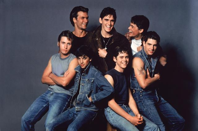 Patrick Swayze, Matt Dillon, Rob Lowe, Emilio Estevez, Ralph Macchio, Thomas C. Howell, and Tom Cruise on the set of The Outsiders, directed by Francis Ford Coppola (Credit: Sunset Boulevard/Corbis via Getty Images)