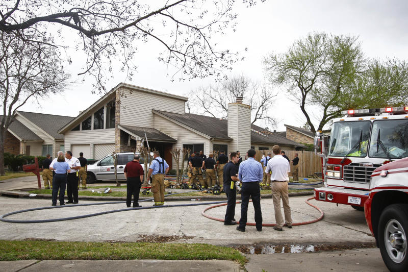 Emergency Personnel respond to the location where a fire broke out at a day care operated by Jessica Tata, 22,  lkilling three children and injuring four others Thursday, Feb. 24, 2011, in Houston. (AP Photo/Houston Chronicle, Michael Paulsen) MANDATORY CREDIT
