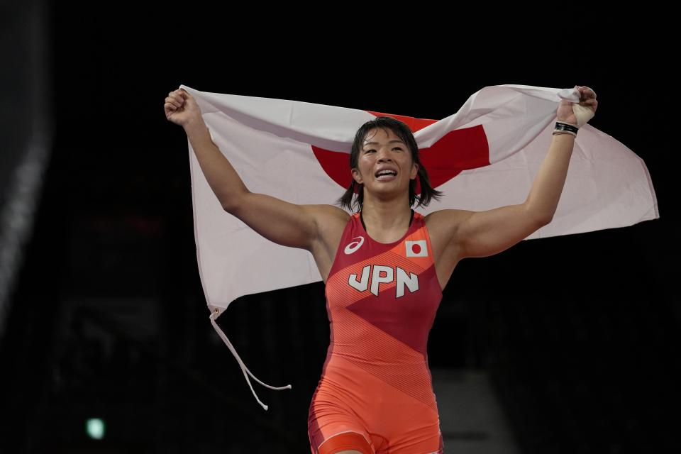 Japan's Risako Kawai celebrates after winning the gold medal defeating Belarus's Iryna Kurachkina during the women's 57kg Freestyle wrestling final match, at the 2020 Summer Olympics, Thursday, Aug. 5, 2021, in Tokyo, Japan. (AP Photo/Aaron Favila)