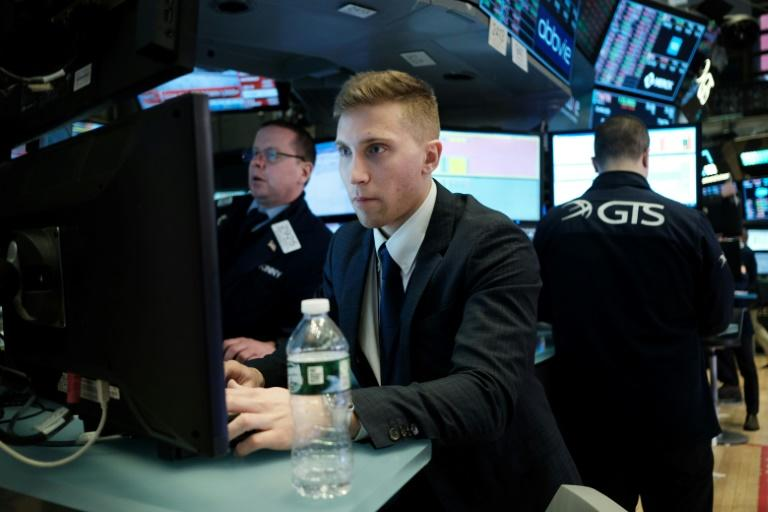 Traders pictured in February 2020 on the floor of the New York stock Exchange, which is braced for a gloomy US jobs report