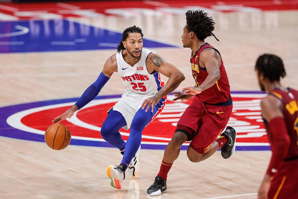 Derrick Rose dribbles against Cavaliers guard Collin Sexton during the second overtime of the Pistons' 128-119 double-overtime loss at Little Caesars Arena on Saturday, Dec. 26, 2020.