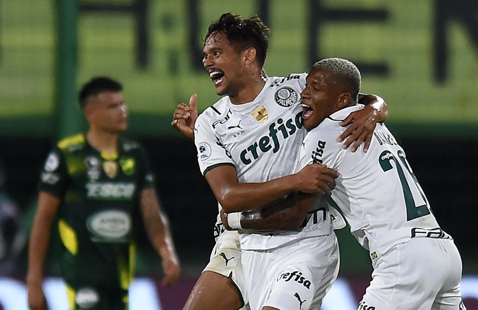 Brazil's Palmeiras Gustavo Scarpa (L) celebrates with teammates after scoring against Argentina's Defensa y Justicia during the Recopa Sudamericana football tournament first leg match at the Norberto Tomaghello stadium in Florencio Varela, Buenos Aires Province, on April 7, 2021. (Photo by Marcelo Endelli / POOL / AFP) (Photo by MARCELO ENDELLI/POOL/AFP via Getty Images)
