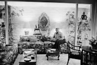 <p>Kirk Douglas lounges in the living room of his Beverly Hills home in 1976.</p>