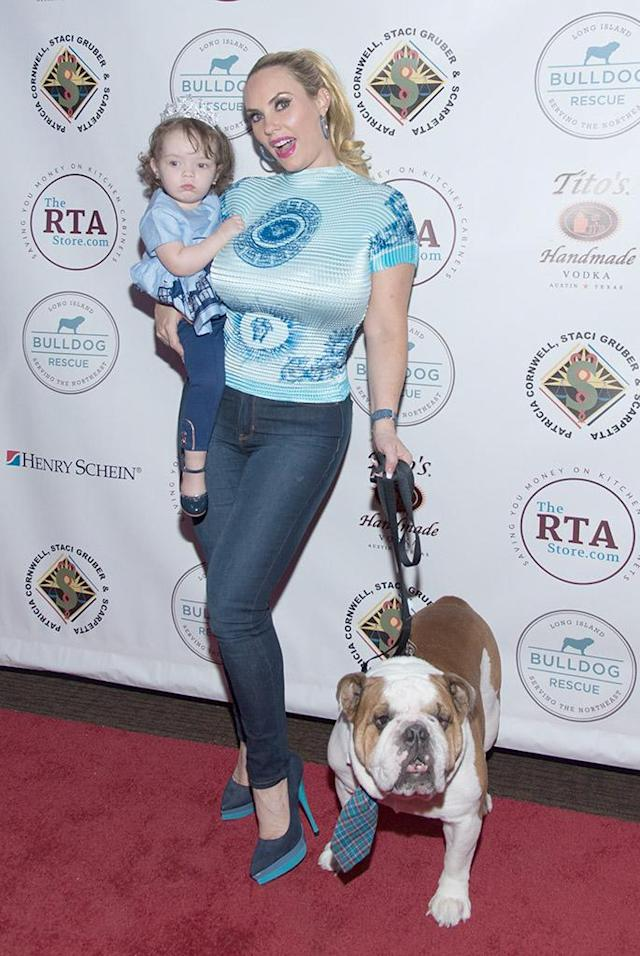 <p>Party of three! Ice-T's favorite ladies and their best pooch hit the red carpet at the 2017 Bash for the Bulldogs at New York University on Monday. (Photo: Yuchen Liao/Getty Images) </p>