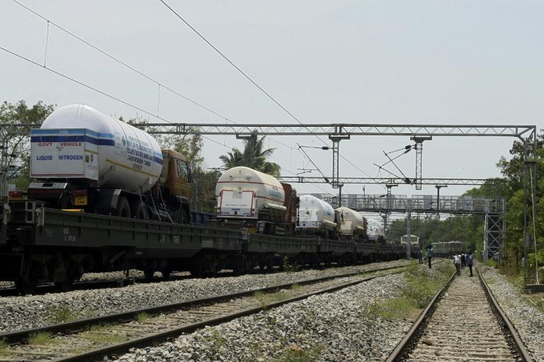 Oxygen tankers are carried into the Indian city of Hyderabad by train