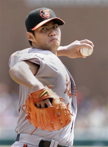Baltimore Orioles starter Wei-Yin Chen pitches against the Detroit Tigers in the first inning of a baseball game on Sunday, Aug. 19, 2012, in Detroit. (AP Photo/Duane Burleson)
