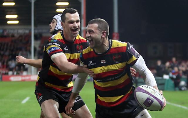 Jonny May celebrates scoring a try for Gloucester - PA