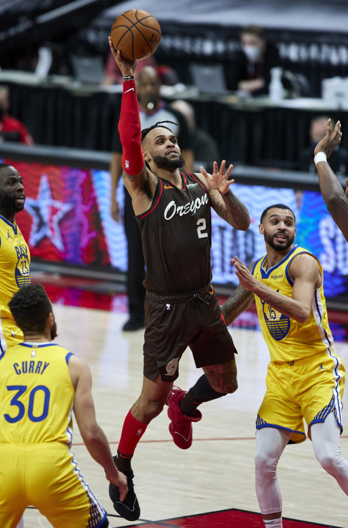 Portland Trail Blazers guard Gary Trent Jr., center, shoots between Golden State Warriors guards Mychal Mulder, right, and Stephen Curry during the second half of an NBA basketball game in Portland, Ore., Wednesday, March 3, 2021. (AP Photo/Craig Mitchelldyer)