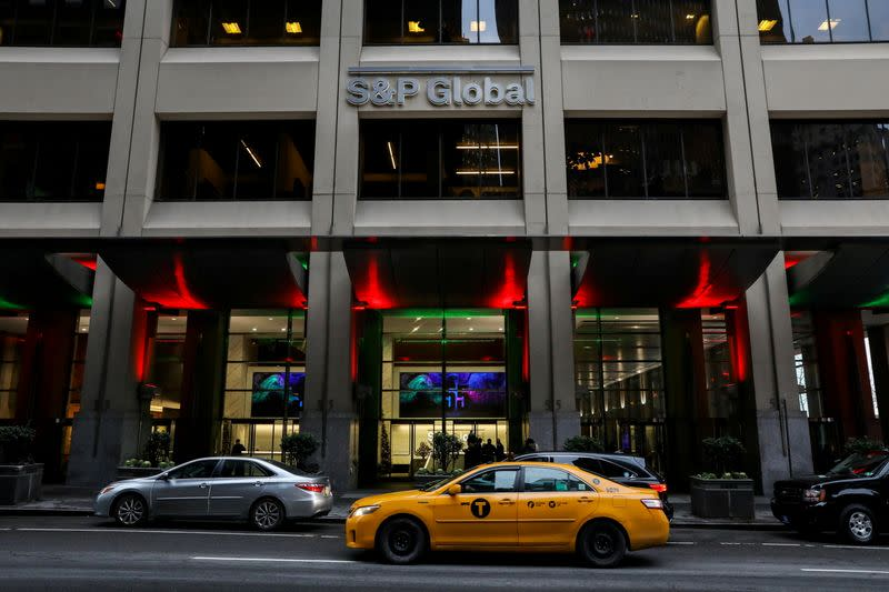 FILE PHOTO: The S&P Global logo is displayed on its offices in the financial district in New York