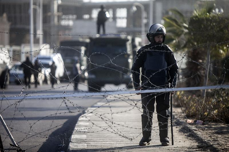 Egyptian security forces stand guard outside the Police Academy in Cairo, on January 28, 2014