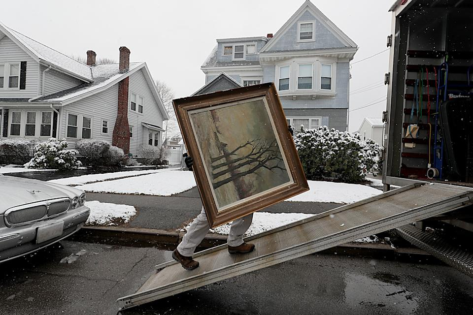 QUINCY, MA - APRIL 2: A piece of artwork belonging to James Pantages is loaded into a truck at his home in Quincy, MA on April 2, 2018. For many years, Pantages spent weekends at area flea markets, art galleries, and auctions scouring for humble treasures hed squirrel away in the ramshackle three-story home he shared with his mother for roughly 60 years. But when his 96-year-old mother entered an assisted living facility earlier this year, Pantages, 69, was finally forced to reckon with what had grown into an unwieldy collection: a sprawling hoard of some 1,200 objects that crowded every inch of their home. Pantages, who retired in 2002 and is now moving into a smaller place, is working with appraiser Peter Smith, who last month began systematically removing and cataloging the collection, a portion of which is slated for sale this September. (Photo by Suzanne Kreiter/The Boston Globe via Getty Images)