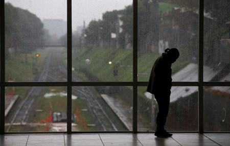 A man stands at the Aristobulo del Valle train station during a national blackout, in Buenos Aires