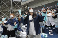Fans wearing face masks to help protect against the spread of the coronavirus cheer during Game 1 of the Korean Series, the Korea Baseball Organization's championship round, between Doosan Bears and NC Dinos at Gocheok Sky Dome in Seoul, South Korea, Tuesday, Nov. 17, 2020. South Korea says it will tighten social distancing rules in the greater Seoul area and some parts of eastern Gangwon province to try to suppress a coronavirus resurgence there. (AP Photo/Ahn Young-joon)