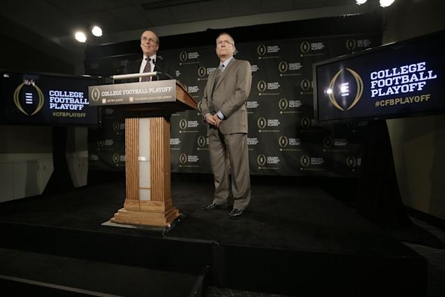 Bowl Championship Series executive director Bill Hancock, left, and Arkansas athletic director Jeff Long, chairman of the College Football Playoff Committee, announce the 12 members selected to the committee during a news conference, Wednesday, Oct. 16, 2013, in Irving, Texas. Former Secretary of State Condoleezza Rice, former Nebraska coach Tom Osborne and College Football Hall of Fame quarterback Archie Manning and Long are among the 13 people who will be part of the College Football Playoff selection committee in 2014. (AP Photo/Tony Gutierrez)