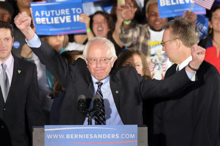 <p>Sen. Bernie Sanders of Vermont acknowledges the cheering crowd at his primary-night rally on Feb. 9, 2016, in Manchester, N.H. (J. David Ake/AP)</p>