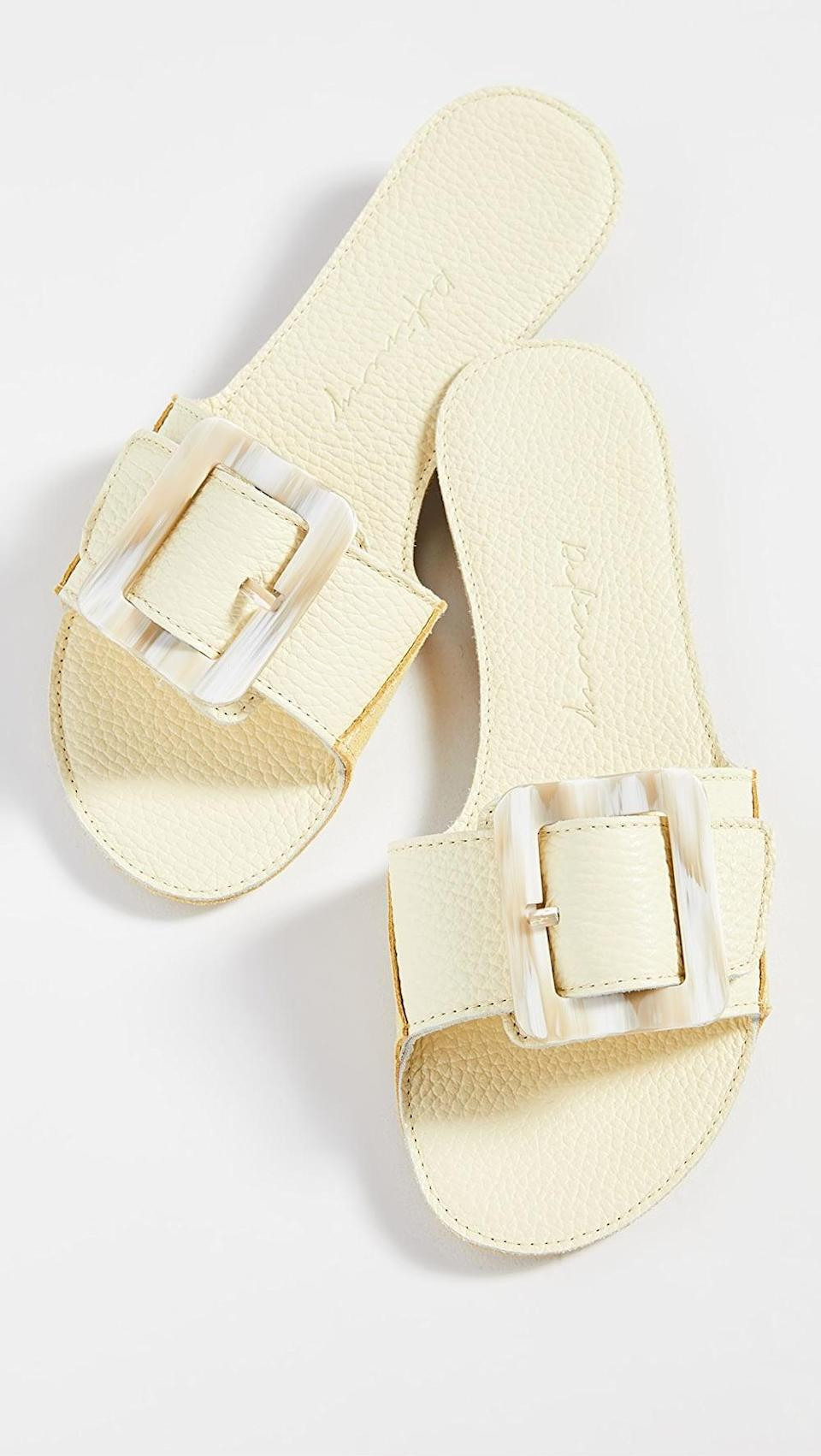 <p>These <span>Definery Loop Open Slides</span> ($226) have a vintage feel that we love.</p>