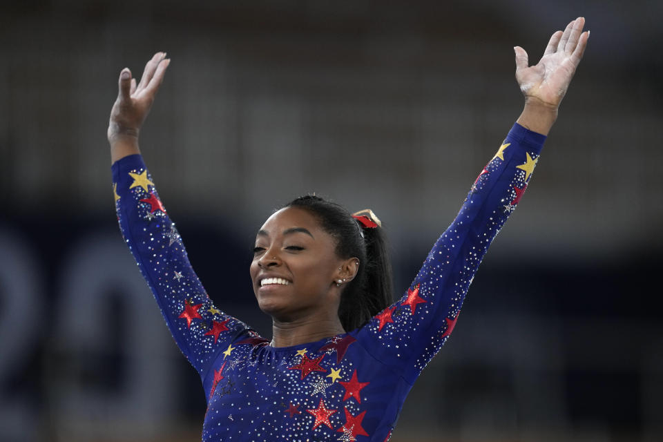 Simone Biles, of the United States, performs her floor routine during the women's artistic gymnastic qualifications at the 2020 Summer Olympics, Sunday, July 25, 2021, in Tokyo. (AP Photo/Natacha Pisarenko)