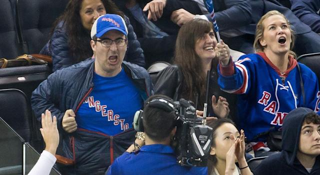 <p>John Oliver goes all out for the New York Rangers at Madison Square Garden.<br> (TM/NHL/Getty Images) </p>