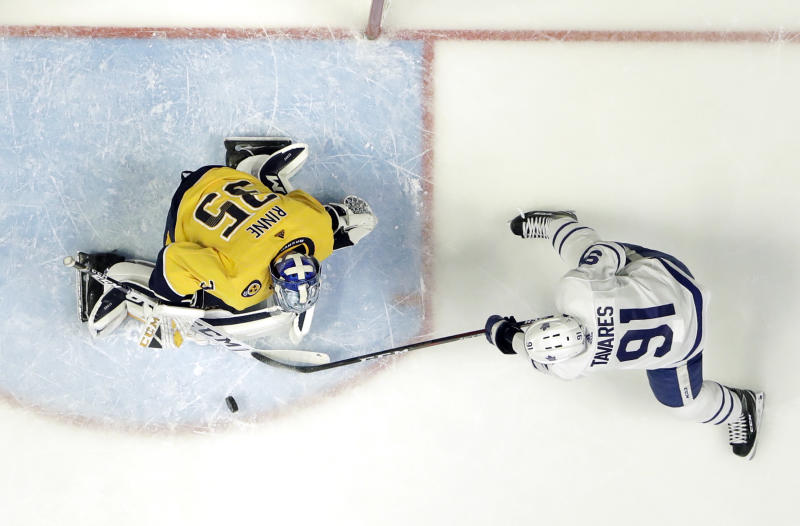 Nashville Predators goaltender Pekka Rinne (35), of Finland, blocks a shot by Toronto Maple Leafs center John Tavares (91) in the second period of an NHL hockey game Tuesday, March 19, 2019, in Nashville, Tenn. (AP Photo/Mark Humphrey)