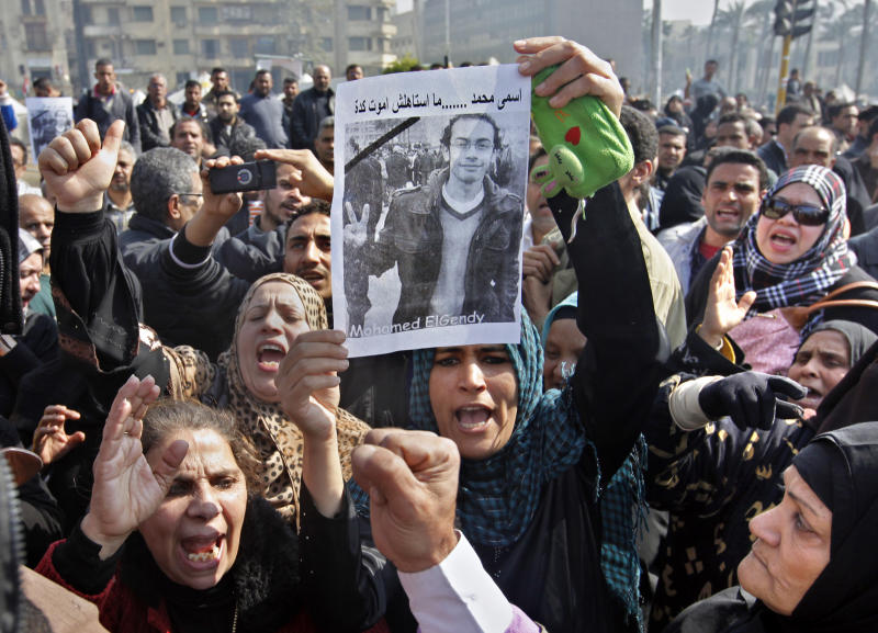 "FILE - In this Monday, Feb. 4, 2013 file photo, Egyptian relatives of Mohammed el-Gindy, a 28-year-old activist, who died of wounds sustained during clashes near the presidential palace, display his picture as they shout anti-president Morsi slogans during his funeral procession in Tahrir Square, Cairo, Egypt.  Arabic reads ""my name is Mohammed and I did not deserve to die this way.""  Watching the events in Tunisia, where a leading anti-Islamist politician was recently assassinated, members of Egypt's liberal opposition are fearfully asking, Could it happen here too? There are reasons for concern: hardline clerics have called for the killing of opposition leaders, and activists say there are worrying signs that show the ruling Islamists are targeting their ranks _ disappearances of activists from protests and telephone death threats. With Islamists convinced the opposition is trying to overthrow President Mohammed Morsi, there is fertile ground for violence. (AP Photo/Amr Nabil, File)"