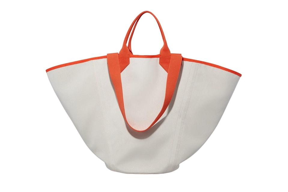 """$175, Rothy's. <a href=""""https://rothys.com/bags/products/the-reversible-tote?color=white-%26-navy"""" rel=""""nofollow noopener"""" target=""""_blank"""" data-ylk=""""slk:Get it now!"""" class=""""link rapid-noclick-resp"""">Get it now!</a>"""